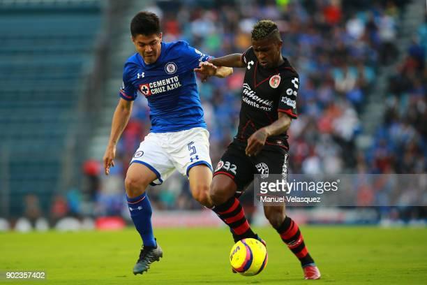 Francisco Silva of Cruz Azul struggles for the ball against Miler Bolanos of Tijuana during the first round match between Cruz Azul and Tijuana as...