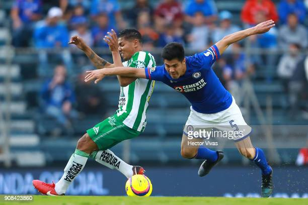 Francisco Silva of Cruz Azul struggles for the ball with Alexander Mejia of Leon during the 3rd round match between Cruz Azul and Leon as part of the...