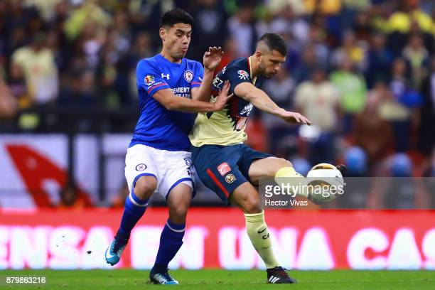 Francisco Silva of Cruz Azul struggles for the ball with Guido Rodriguez of America during the quarter finals second leg match between America and...