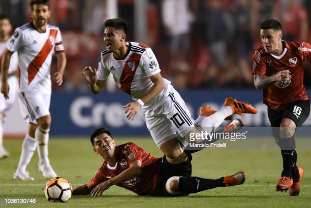 Francisco Silva of Independiente fights for the ball with Gonzalo Martinez of River Plate during a quarter final first leg match between...