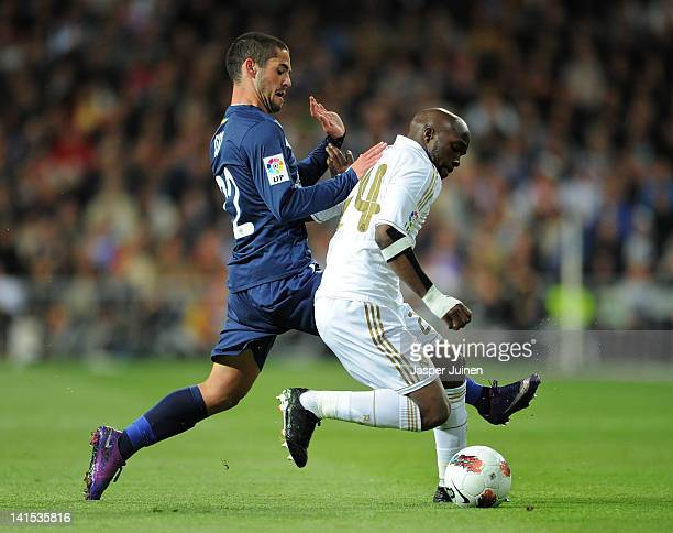 Francisco Suarez of Malaga duels for the ball with Lassana Diarra of Real Madrid during the la Liga match between Real Madrid CF and Malaga CF at the...