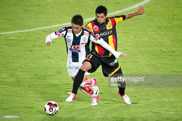 Francisco Torres of Pachuca struggles for the ball with Edwin Borboa of Leones Negros during a match between Pachuca and Leones Negros as part of the...