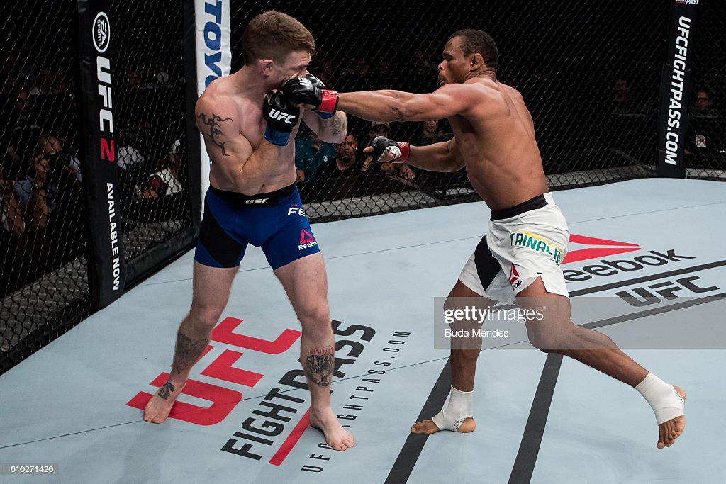 Francisco Trinaldo of Brazil punches Paul Felder of the United States in their lightweigh UFC bout during tthe UFC Fight Night event at Nilson Nelson gymnasium on September 24, 2016 in Brasilia, Brazil.