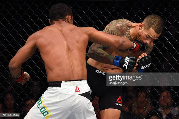 Francisco Trinaldo of Brazil punches Yancy Medeiros in their lightweight bout during the UFC 198 event at Arena da Baixada stadium on May 14, 2016 in...