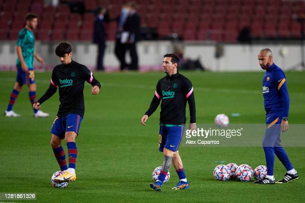 Francisco Trincao and Lionel Messi of FC Barcelona warm up prior to the UEFA Champions League Group G stage match between FC Barcelona and...
