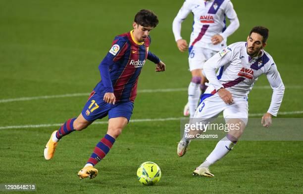 Francisco Trincao of Barcelona and Pedro Bigas of SD Eibar in action during the La Liga Santander match between FC Barcelona and SD Eibar at Camp Nou...