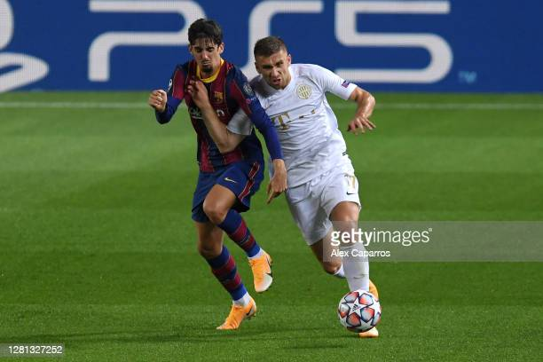 Francisco Trincao of FC Barcelona battle for possession with Eldar Civic of Ferencvaros Budapest during the UEFA Champions League Group G stage match...