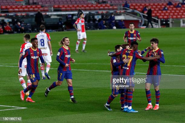 Francisco Trincao of FC Barcelona celebrates with Antoine Griezmann and team mates after scoring their side's first goal during the La Liga Santander...