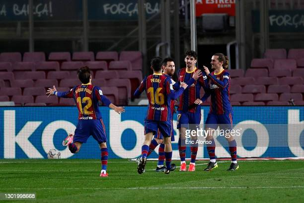 Francisco Trincao of FC Barcelona celebrates with team mates Ricard Puig Marti, Pedri, Lionel Messi and Antoine Griezmann after scoring their side's...