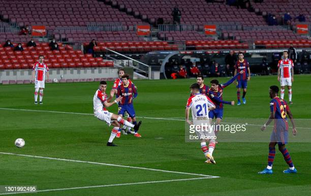 Francisco Trincao of FC Barcelona scores their side's first goal during the La Liga Santander match between FC Barcelona and Deportivo Alavés at Camp...