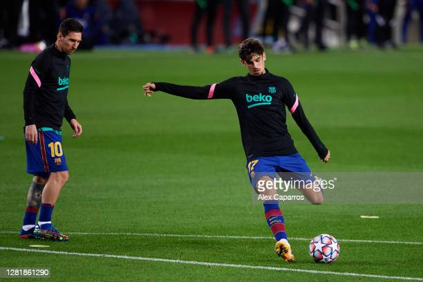 Francisco Trincao of FC Barcelona warms up next to his teammate Lionel Messi prior to the UEFA Champions League Group G stage match between FC...