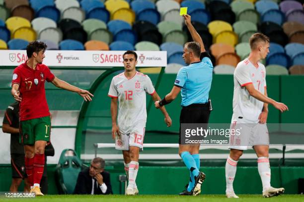 Francisco Trincao of Portugal Sergio Reguilon of Spain referee Paolo Valeri during the International Friendly match between Portugal v Spain at the...
