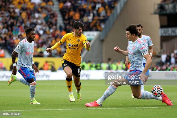 Francisco Trincao of Wolverhampton Wanderers battles for possession with Fred and Harry Maguire of Manchester United during the Premier League match...