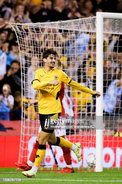Francisco Trincao of Wolverhampton Wanderers celebrates after scoring his team's third goal during the Carabao Cup Second Round match between...