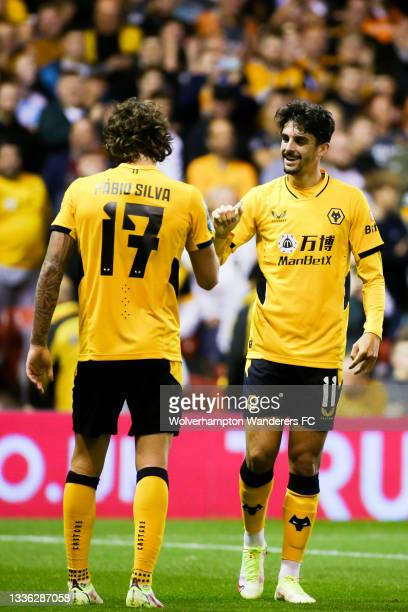 Francisco Trincao of Wolverhampton Wanderers celebrates scoring his team's third goal with Fabio Silva during the Carabao Cup Second Round match...