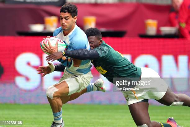 Francisco Ulloa of Argentina runs the ball in to the endzone while being tackled by Sakoyisa Makata of South Africa during day 2 of the 2019 Canada...