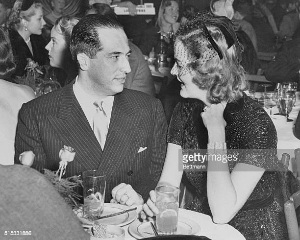 Francisco Urrutia of Columbia and heiress Doris Duke give an international flavor to the El Morocco Night Club as they are seen together chatting...