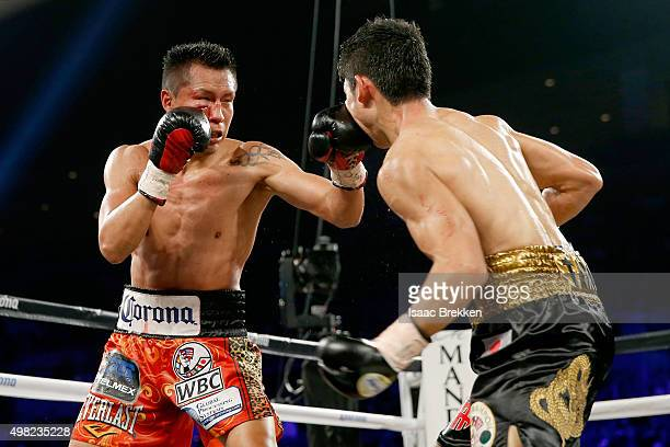 Francisco Vargas connects with a left to the face of Takashi Miura in their WBC super featherweight title fight at the Mandalay Bay Events Center on...