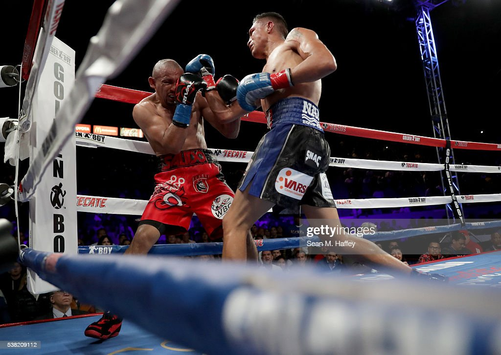 Francisco Vargas (R) lands a right to the head of Orlando Salido during their WBC super featherweight championship bout at StubHub Center on June 4, 2016 in Carson, California.
