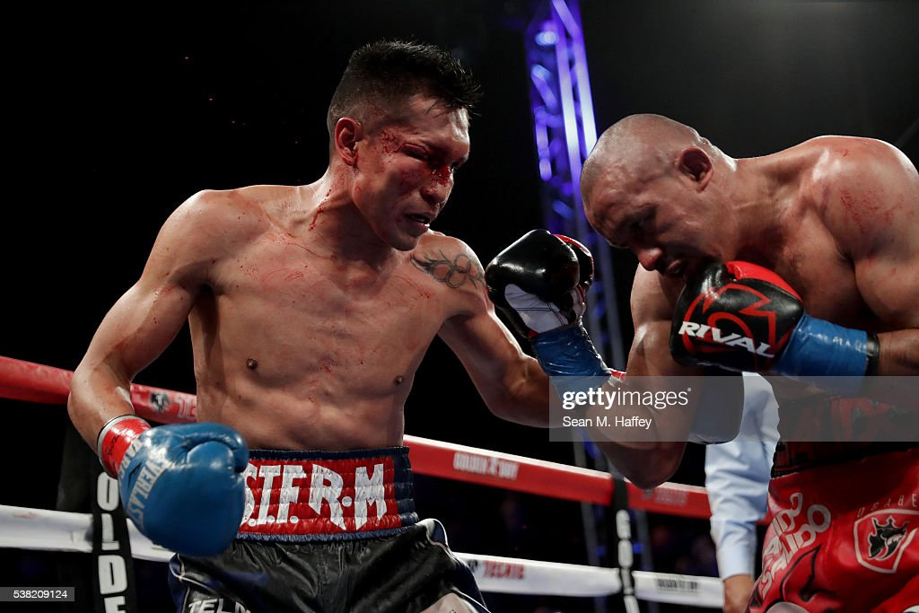 Francisco Vargas (L) lands a right to the head of Orlando Salido during their WBC super featherweight championship bout at StubHub Center on June 4, 2016 in Carson, California.