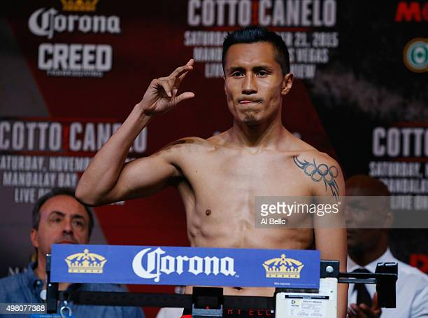 Francisco Vargas poses on the scale during his official weighin at the Mandalay Bay Events Center on November 20 2015 in Las Vegas Nevada Vargas will...