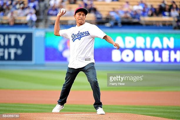 Francisco Vargas the WBC super featherweight champion throws out the ceremonial first pitch before the Los Angeles Dodgers take on the Cincinnati...