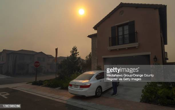 Francisco Vega prepares to evacuate his wife and daughter from their house in the Orchard Hills community in Irvine, CA on Monday, October 26, 2020....