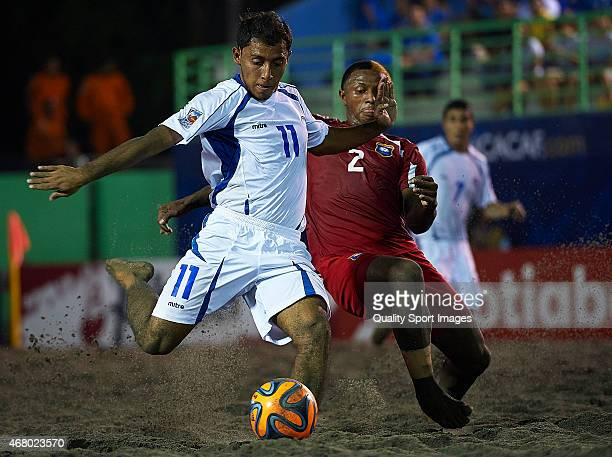 Francisco Velasquez of El Salvador competes for the ball with Sean Mas of Belize during day one of the CONCACAF Beach Soccer Championships El...