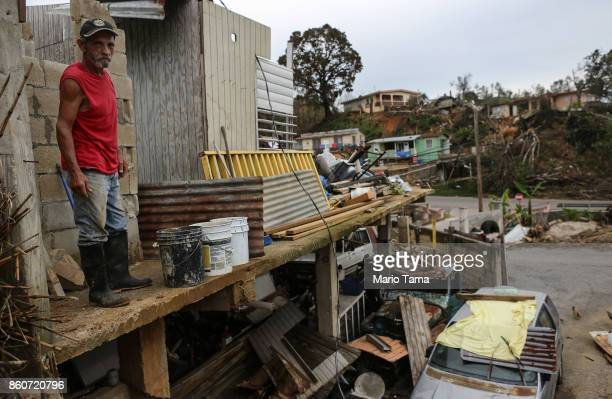 Francisco Zamoro poses while working to repair his destroyed home three weeks after Hurricane Maria hit the island on October 12 2017 in Jayuya...