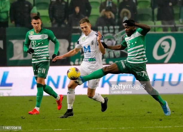 Franck Boli of Ferencvarosi TC competes for the ball with Yoell van Nieff of Puskas Akademia FC before Oleksandr Zubkov of Ferencvarosi TC during the...