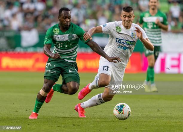 Franck Boli of Ferencvarosi TC competes for the ball with Zsombor Berecz of Mezokovesd Zsory FC during the Hungarian OTP Bank Liga match between...