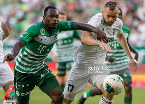 Franck Boli of Ferencvarosi TC fights for the ball with Róbert Pillár of Mezokovesd Zsory FC during the Hungarian OTP Bank Liga match between...