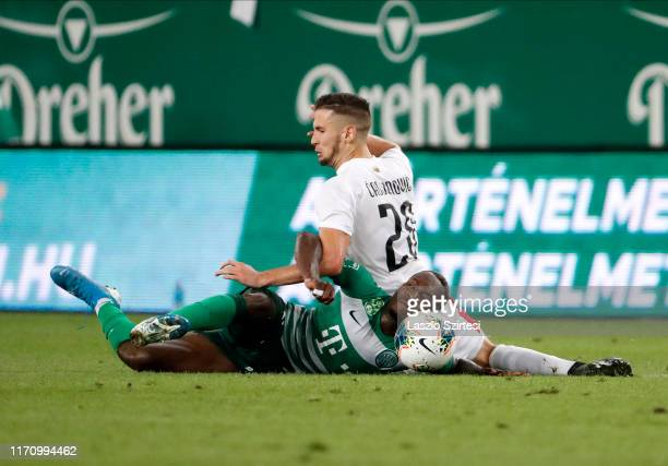 Franck Boli of Ferencvarosi TC is fouled by Jovan Cadjenovic of FK Suduva during the UEFA Europa League Play-off Second Leg match between...
