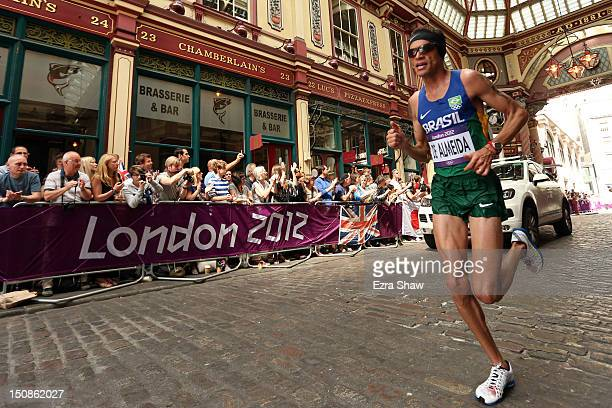 Franck Caldeira de Almeida of Brazil runs through Leadenhall Market as he competes in the Men's Marathon on Day 16 of the London 2012 Olympic Games...
