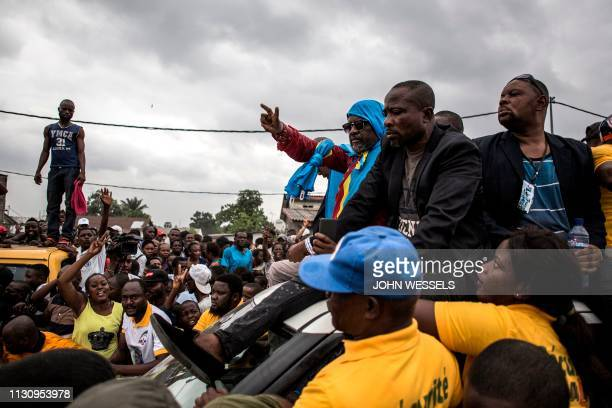 Franck Diongo , the leader of the Lumumbist Progressive Movement political party, waves to supporters during his release after two years in prison on...