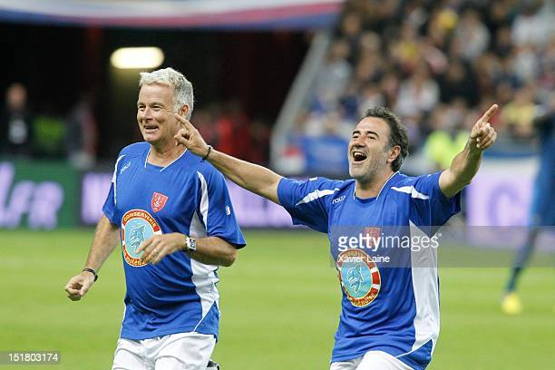 Franck Dubosc and Jose Garcia kick off and promote the new film 'Les Seigneurs' before the FIFA 2014 World Cup Qualifer between France and Belarus at...