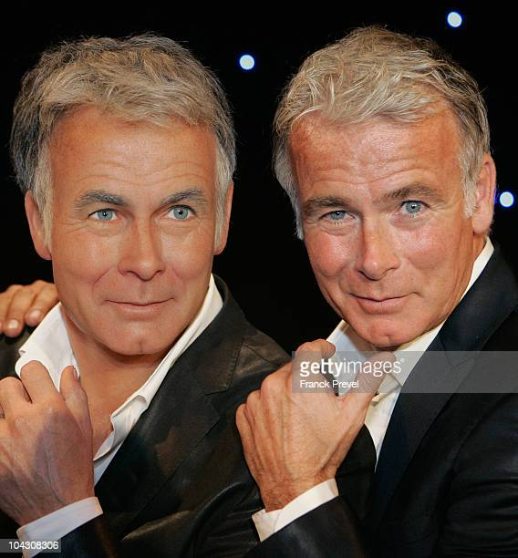 Franck Dubosc poses next to his waxwork during its unveiling at Musee Grevin on September 20 2010 in Paris France