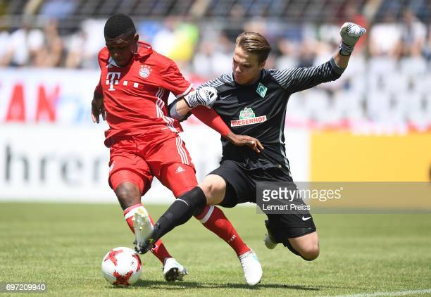 Franck Evina of FC Bayern Muenchen challenges Luca Plogmann of SV Werder Bremen during the B Juniors German Championship Final between FC Bayern...