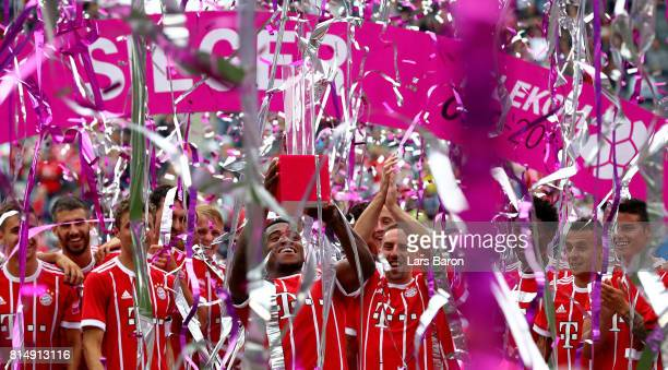 Franck Evina of Muenchen celebrates with the trophy after winning the Telekom Cup 2017 Final between SV Werder Bremen and FC Bayern Muenchen at...