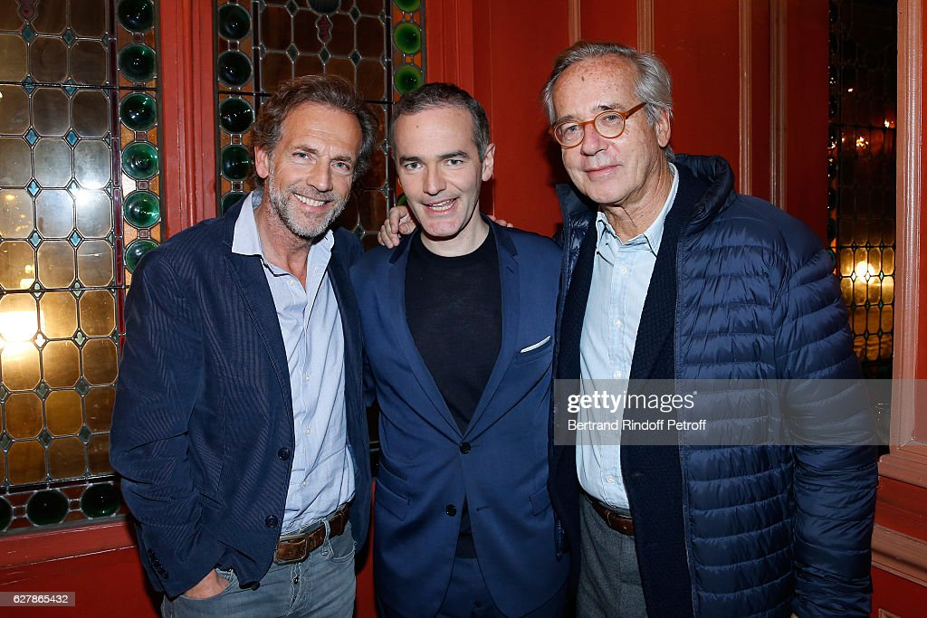 Franck Ferrand standing between Actor Stephane Freiss (L) and Olivier Orban (R) pose after Franck Ferrand performed in his Show 'Histoires' at Theatre Antoine on December 5, 2016 in Paris, France.