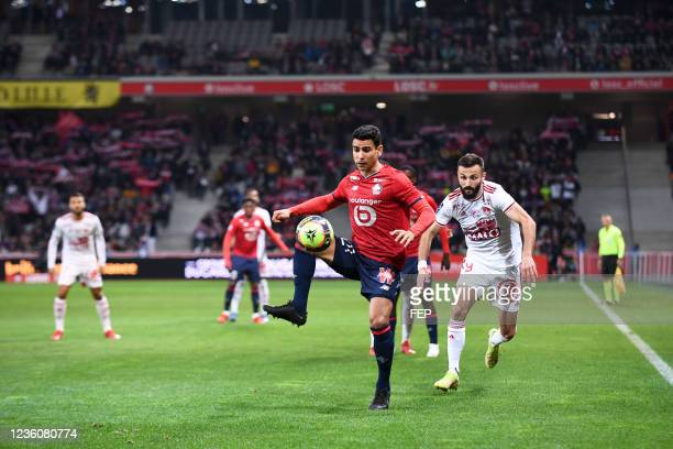 Franck HONORAT - 21 Benjamin ANDRE during the Ligue 1 Uber Eats match between Lille and Brest at Stade Pierre Mauroy on October 23, 2021 in Lille,...