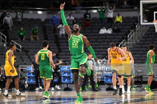 Franck Kepnang of the Oregon Ducks reacts to a score against the Iowa Hawkeyes in the second round game of the 2021 NCAA Men's Basketball Tournament...