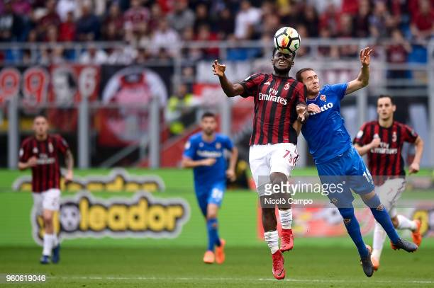 Franck Kessie competes for a header with Sebastian Cristoforo of ACF Fiorentina during the Serie A football match between AC Milan and ACF Fiorentina...