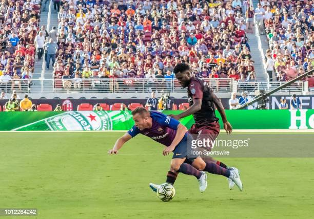 Franck Kessie Midfielder, AC Milan gets Arthur Melo Midfielder, FC Barcelona from behind to the ground during the International Champions Cup match...