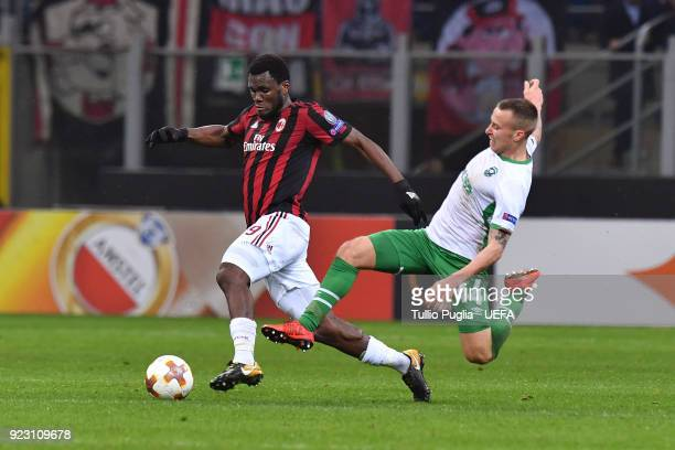 Franck Kessie of AC Milan and Jacek Goralski of Ludogorets Razgrad compete for the ball during UEFA Europa League Round of 32 match between AC Milan...