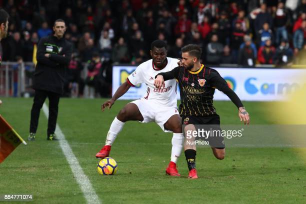Franck Kessie of AC Milan and Vittorio Parigini of Benevento Calcio during the Serie A match between Benevento Calcio and AC Milan at Stadio Ciro...
