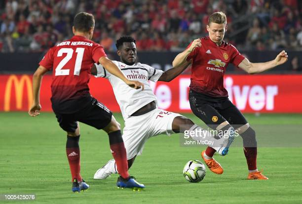 Franck Kessie of AC Milan battles for the ball with Ander Herrera and Scott McTominay of Manchester United in the first half during the International...