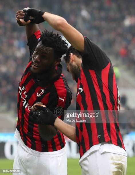 Franck Kessie of AC Milan celebrates his goal with his teammate Hakan Calhanoglu during the Serie A match between AC Milan and Parma Calcio at Stadio...
