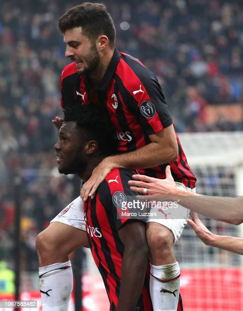 Franck Kessie of AC Milan celebrates his goal with his teammate Patrick Cutrone during the Serie A match between AC Milan and Parma Calcio at Stadio...