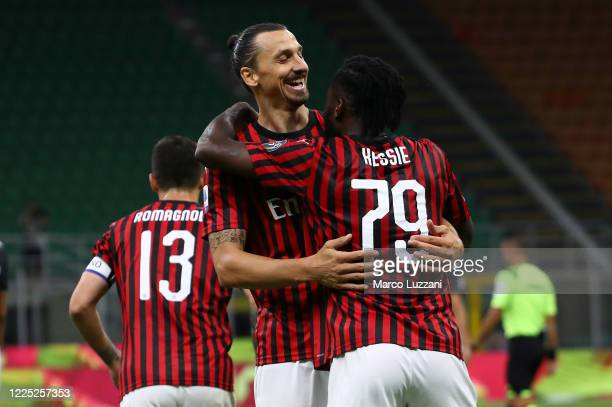 Franck Kessie of AC Milan celebrates his goal with his teammate Zlatan Ibrahimovic during the Serie A match between AC Milan and Juventus at Stadio...